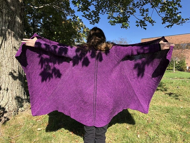A large fuchsia shawl.