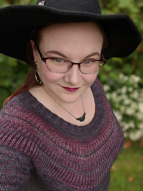 A gray and purple colorwork sweater.