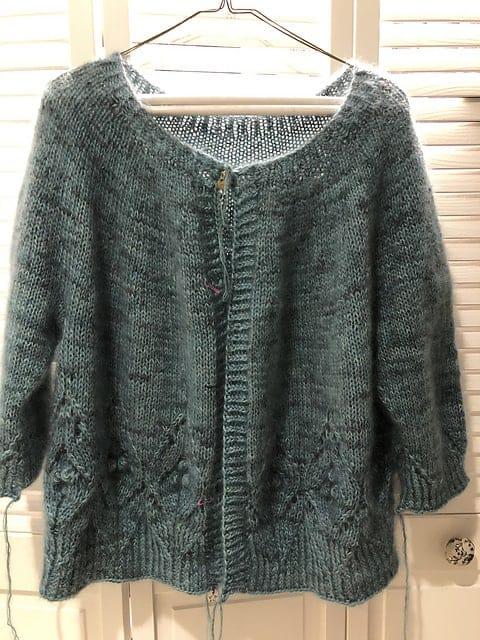 A green sweater.