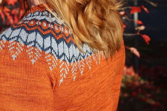 An orange colorwork sweater.