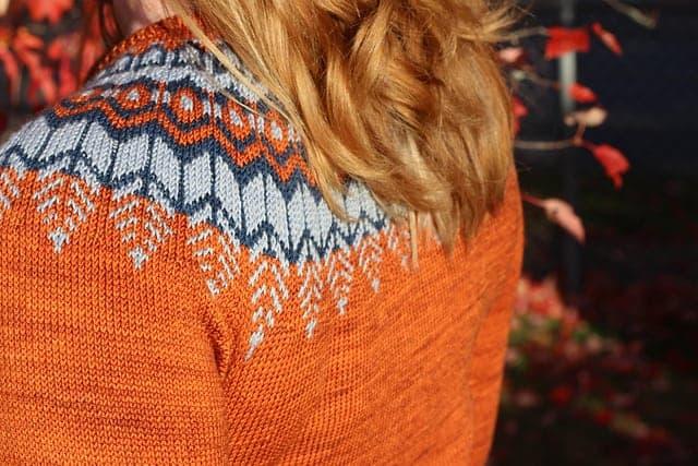 An orange colorwork sweater.