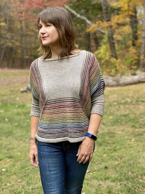 A grey sweater with rainbow stripes.
