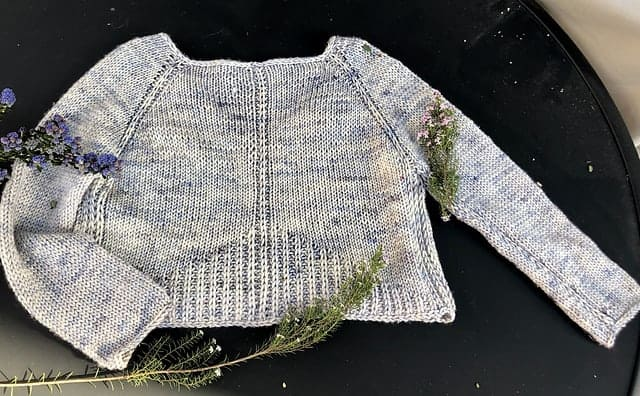 A gray speckled sweater.