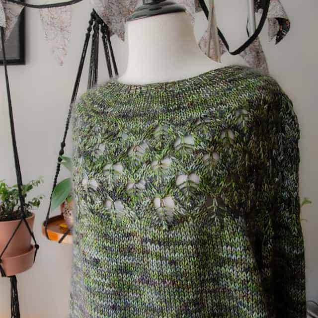 A green lacy sweater.