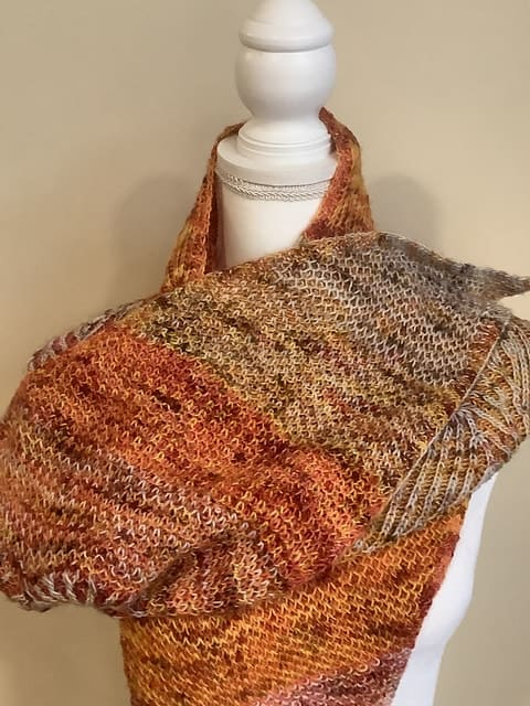 An orange and brown speckled shawl.