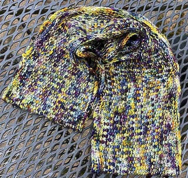 A purple, blue and gold textured cowl.