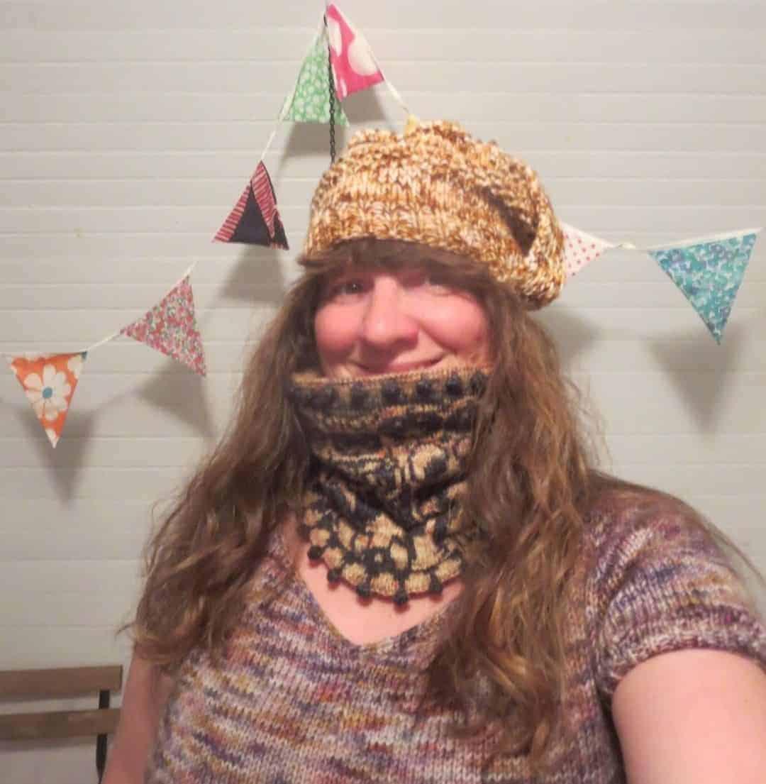 A woman models knitwear.