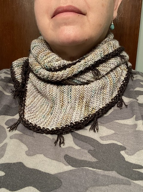 A gray speckled cowl.