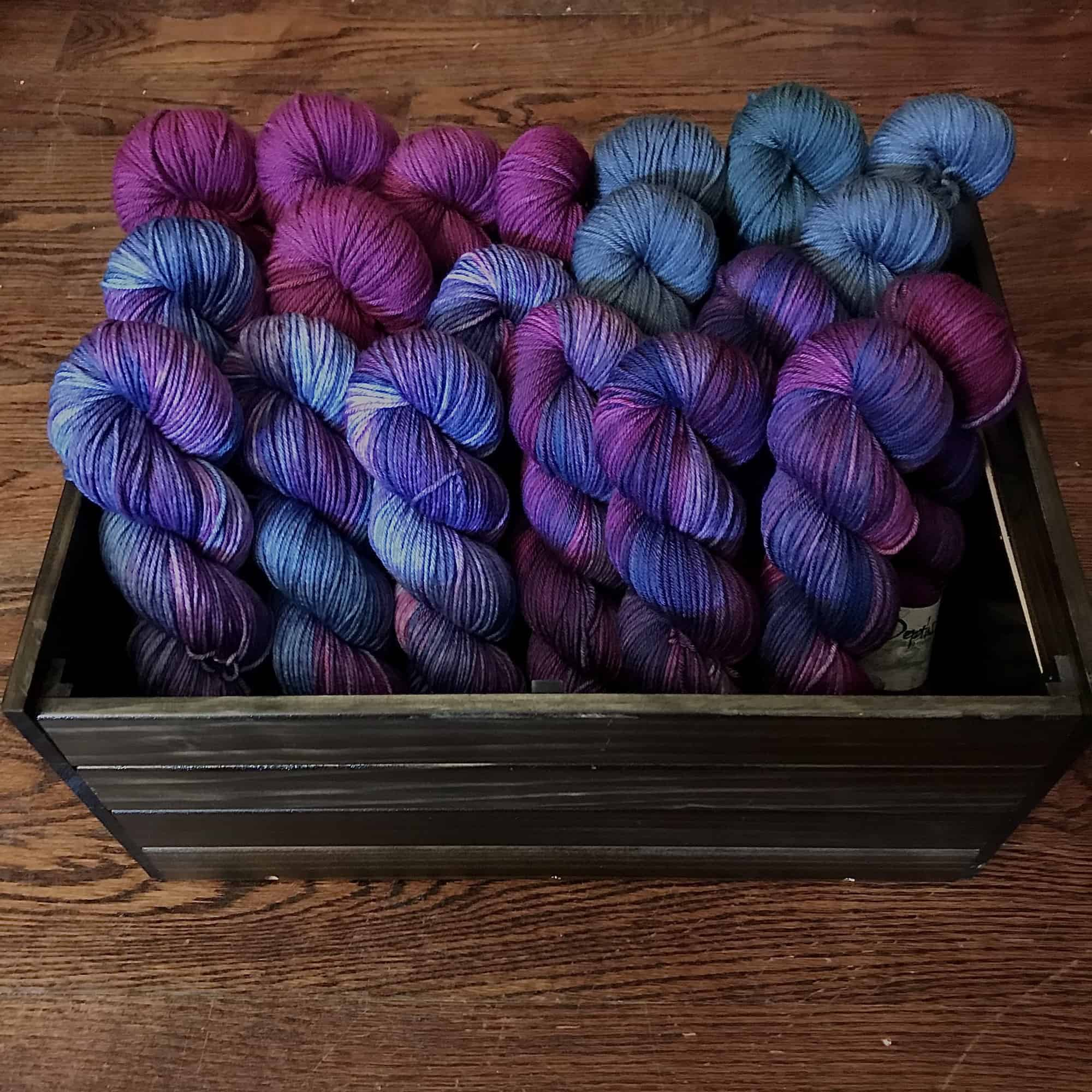 Skeins of purple and blue yarn.