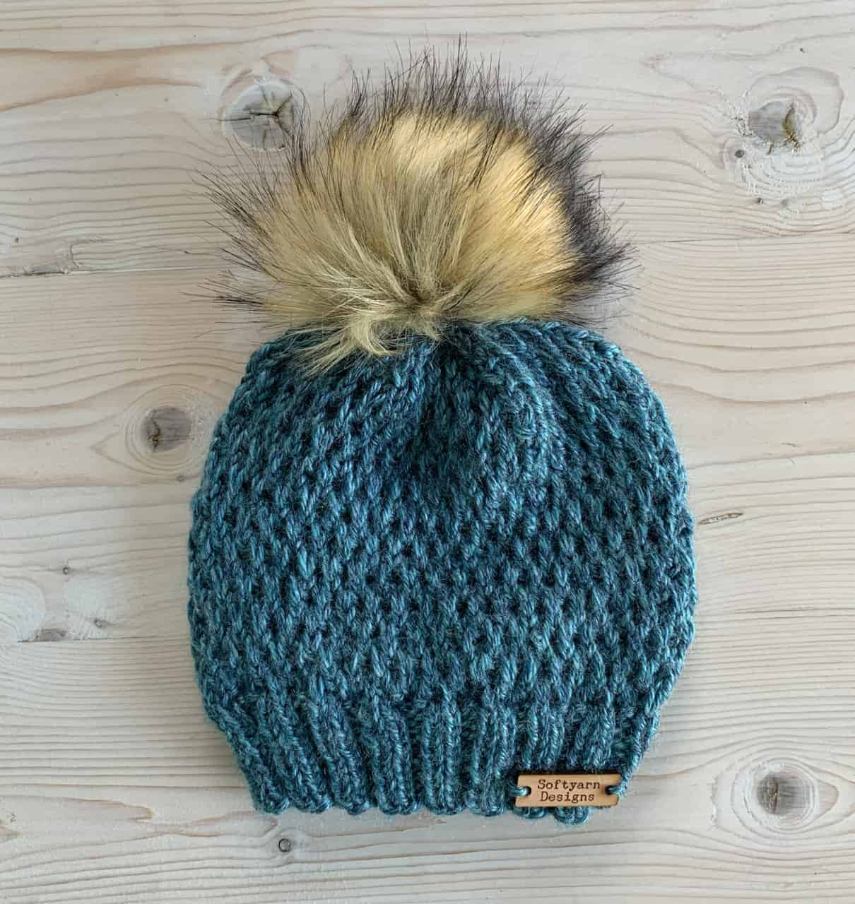 A teal textured hat.