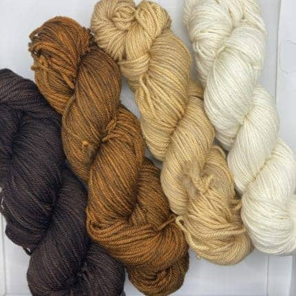 Hanks of brown, beige and cream yarn.