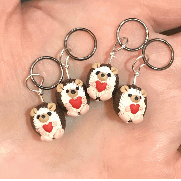 Hedgehogs holding hearts.