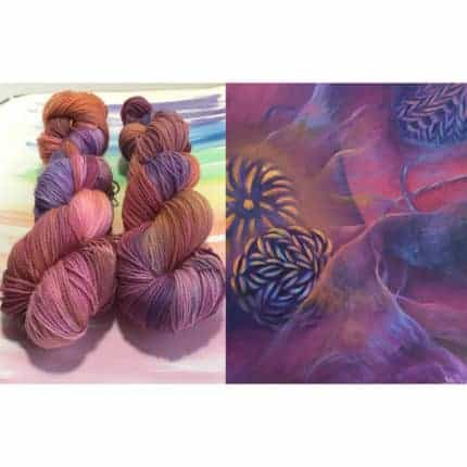 Purple and blue yarn next to a purple and blue painting.