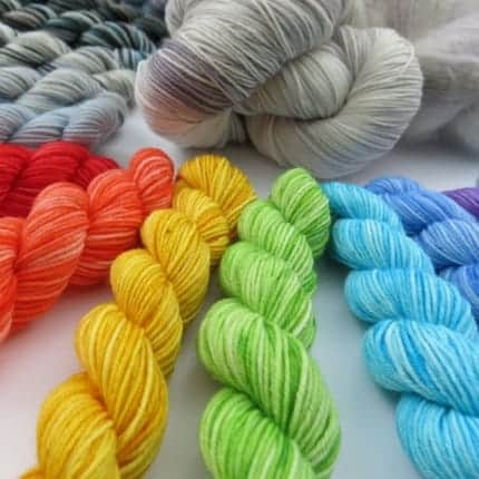 Mini skeins of rainbow yarn.