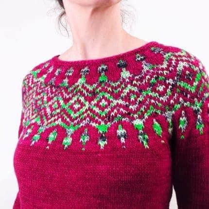 A fuchsia sweater with a bright green colorwork yoke.