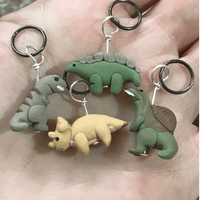 Green, gray and gold clay dinosaurs.