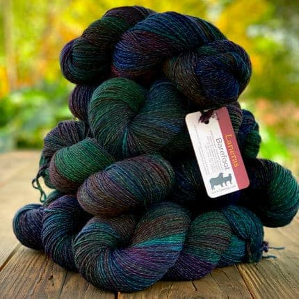 Black yarn with pops of green, blue and purple.