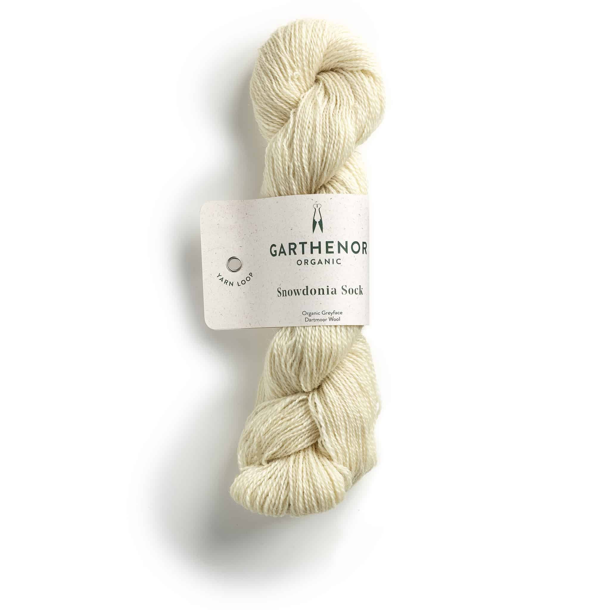 A skein of cream-colored yarn that says Dartmoor.