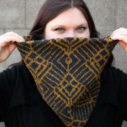 A black and gold Art Deco-inspired cowl.