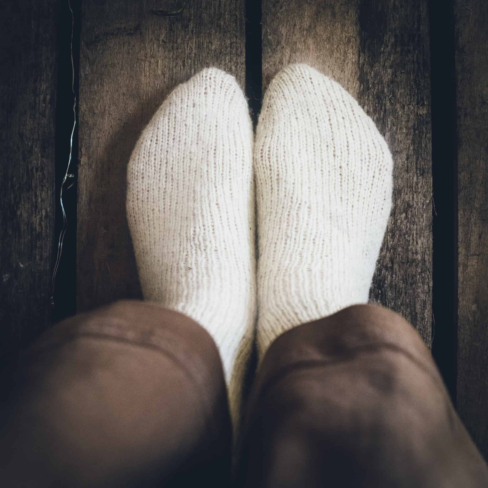 A view of white handknit socks from above.