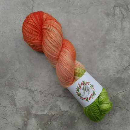 A single skein of orange and green yarn.