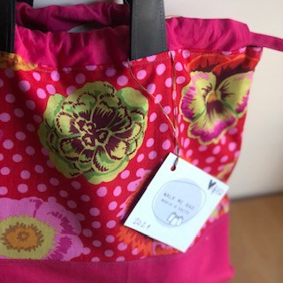 A pink bag with gold flowers.