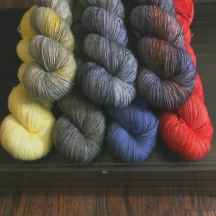 Gray, yellow, blue and red yarn.