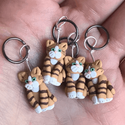 Striped ginger cat stitch markers.
