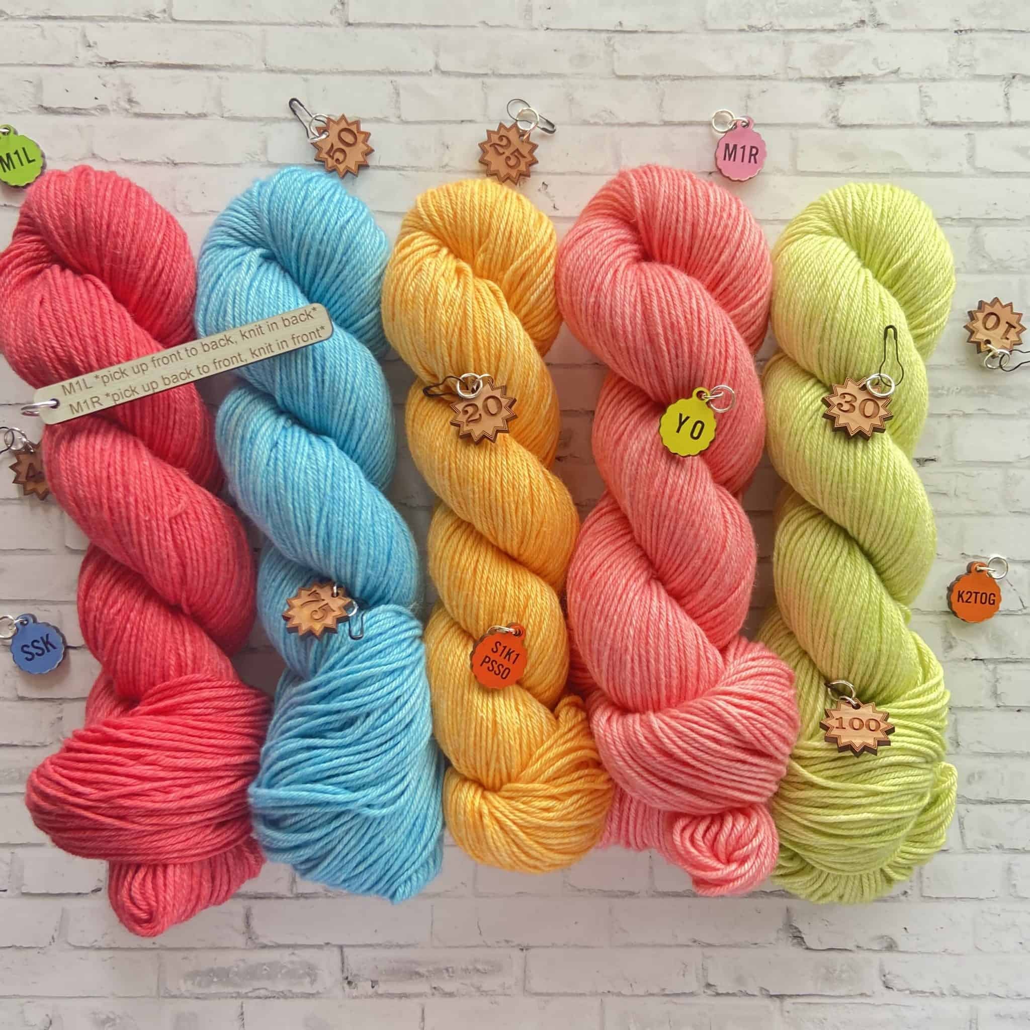 Skeins of bright pink, blue, orange and green yarn.