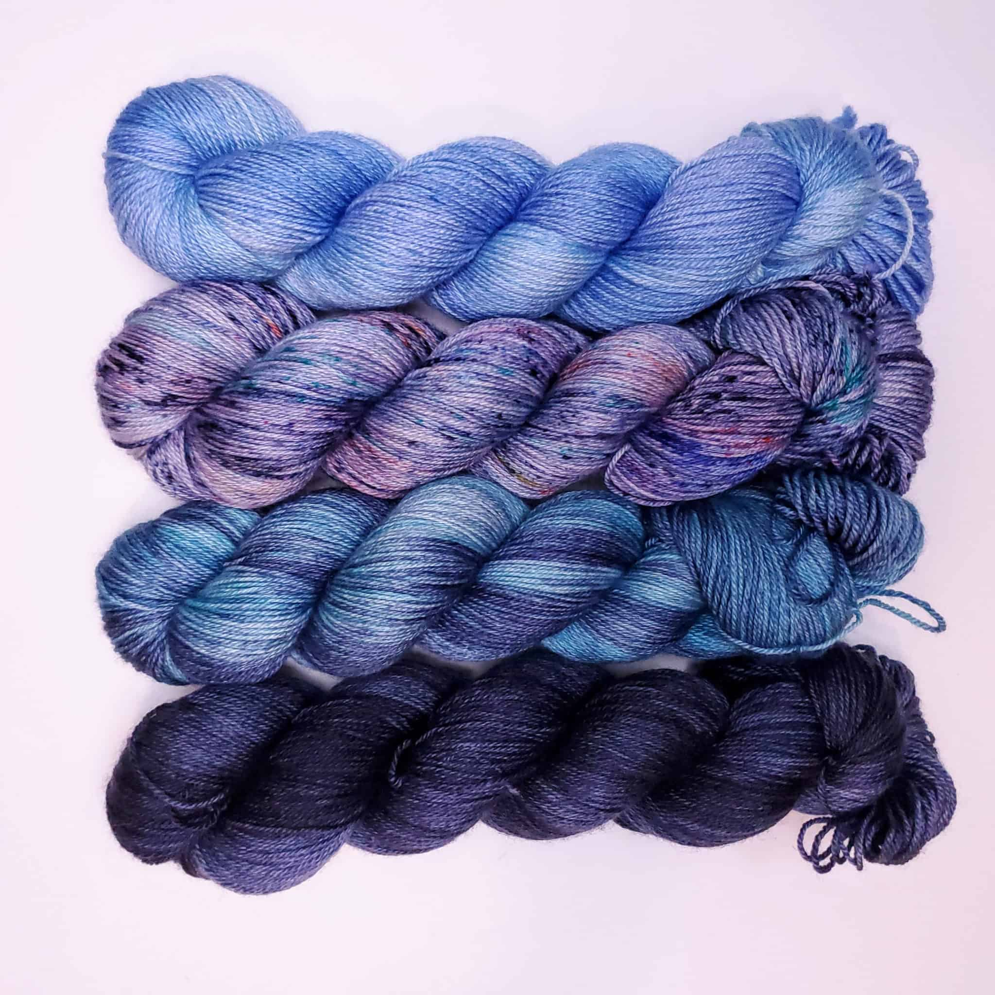 Skeins of yarn in shades of blue and purple.