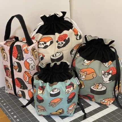 Four bags with colorful animal sushi fabric.