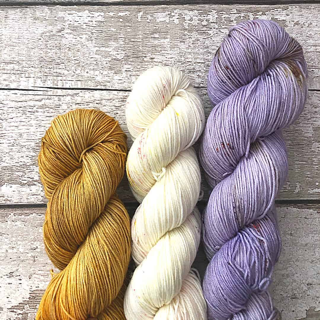 Gold, cream and lilac yarn.
