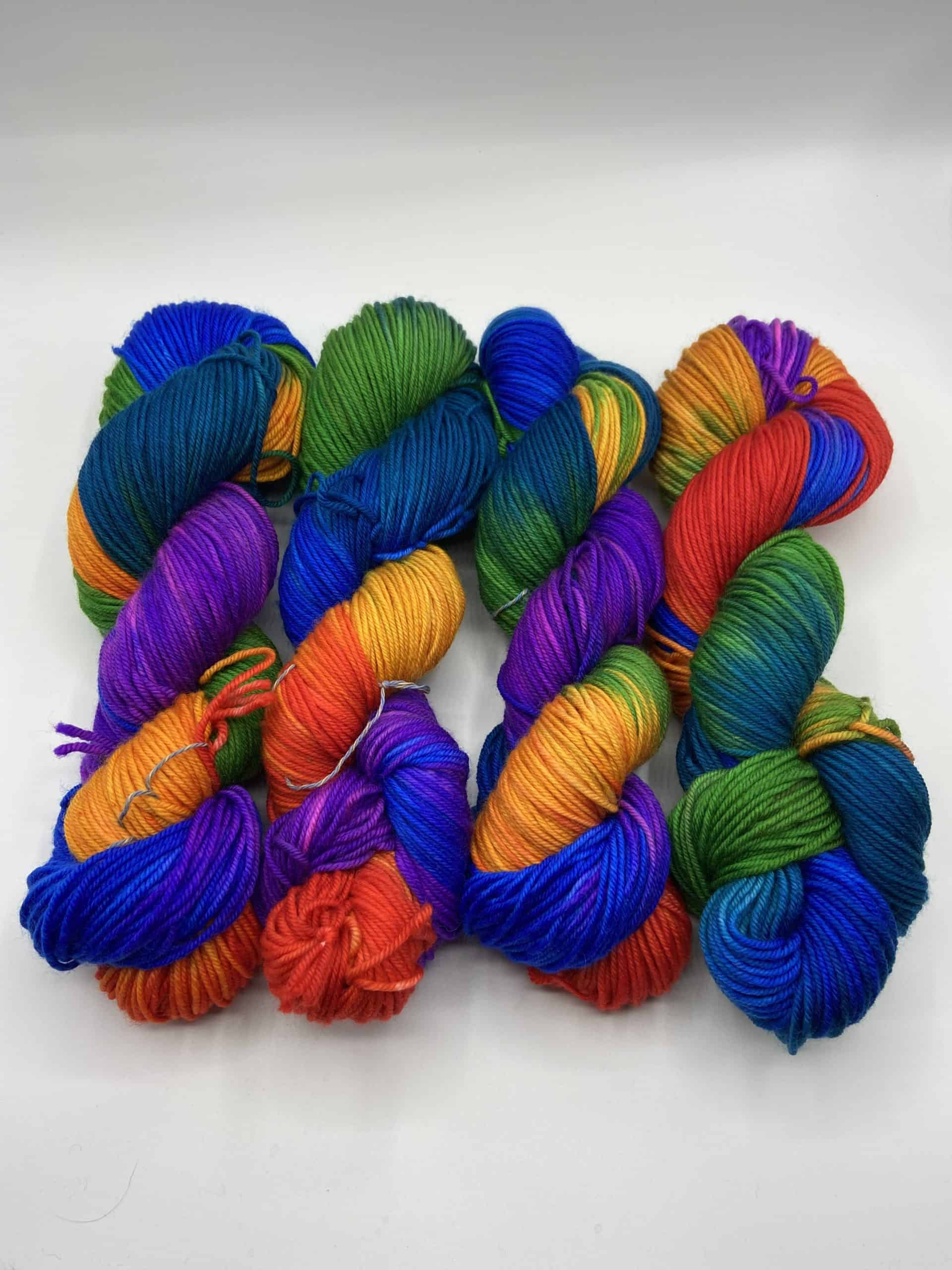 Skeins of blue, orange, purple, green and yellow yarn.