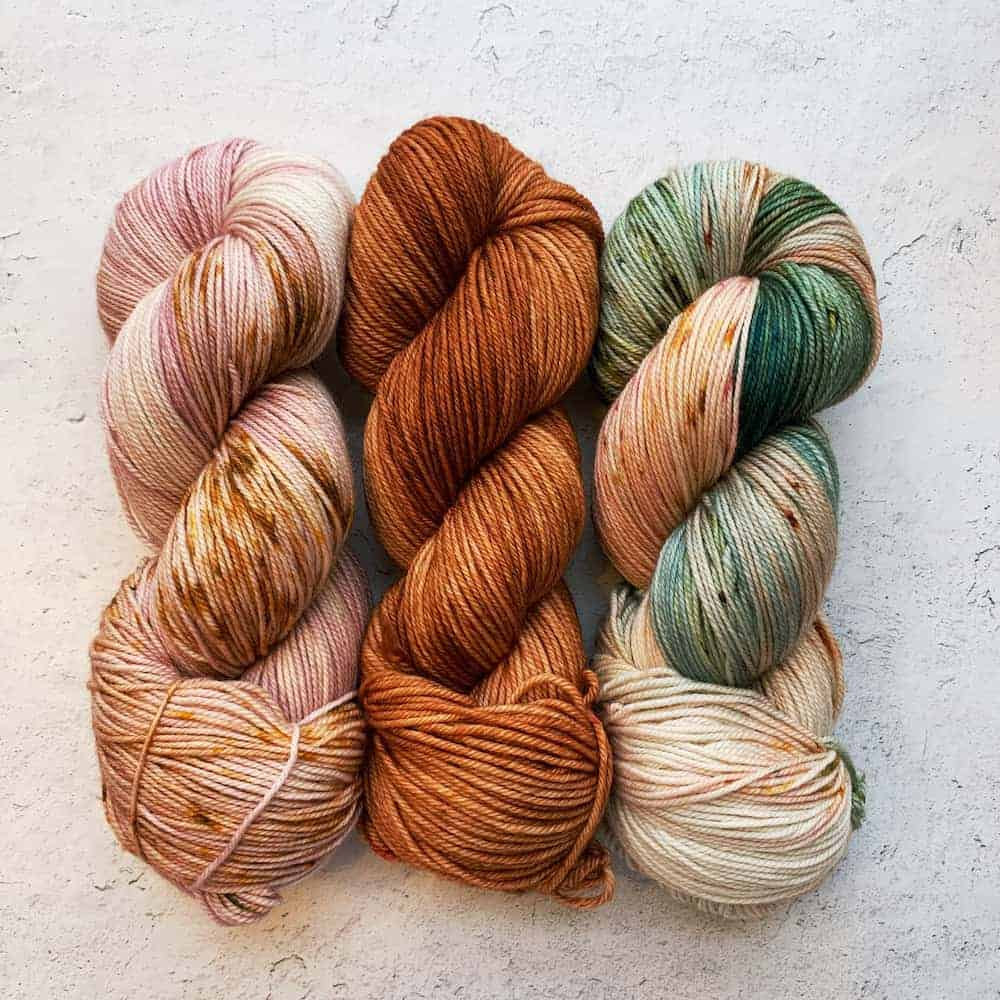Pink, orange and orange and green yarn.