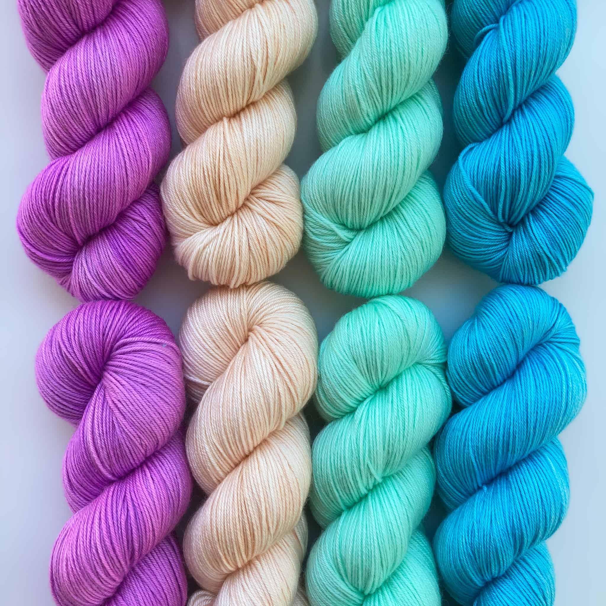 Purple, pink, aqua and blue yarn.
