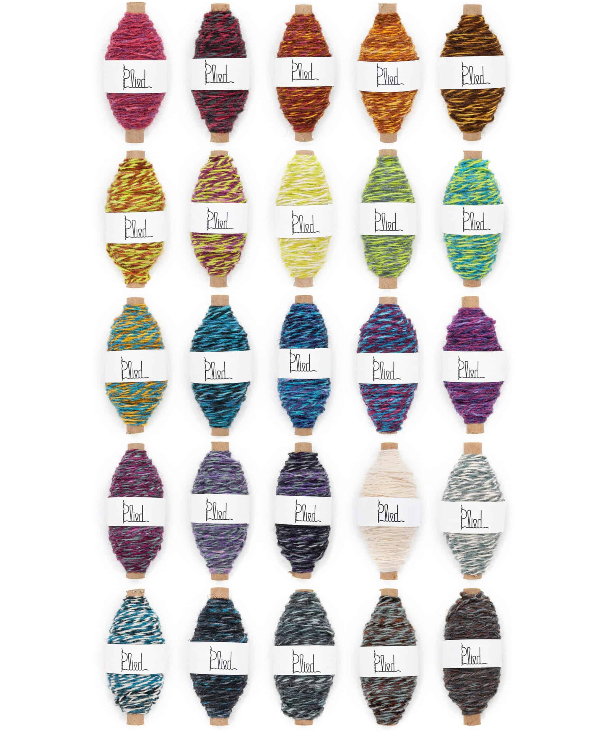 Bobbins of colorful yarn.