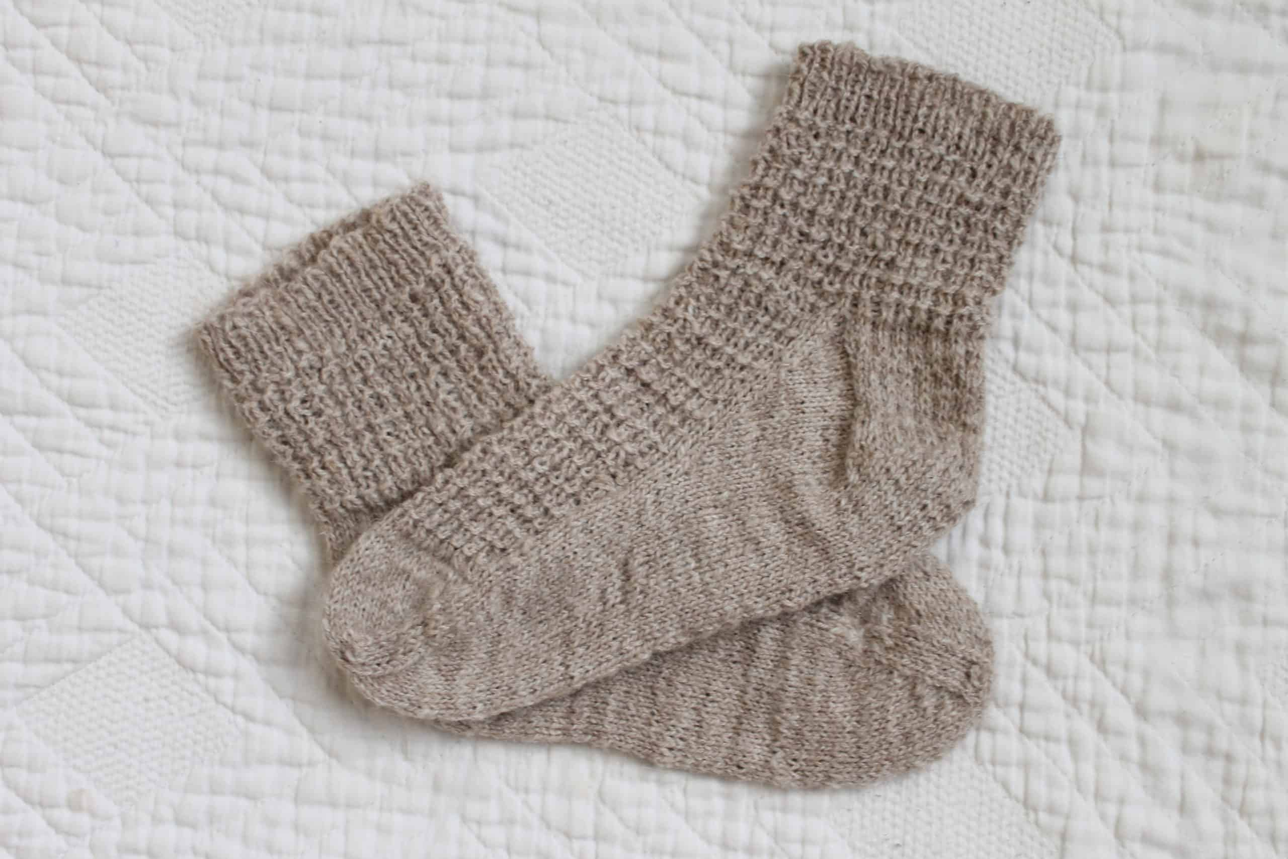 A pair of cream-colored socks.
