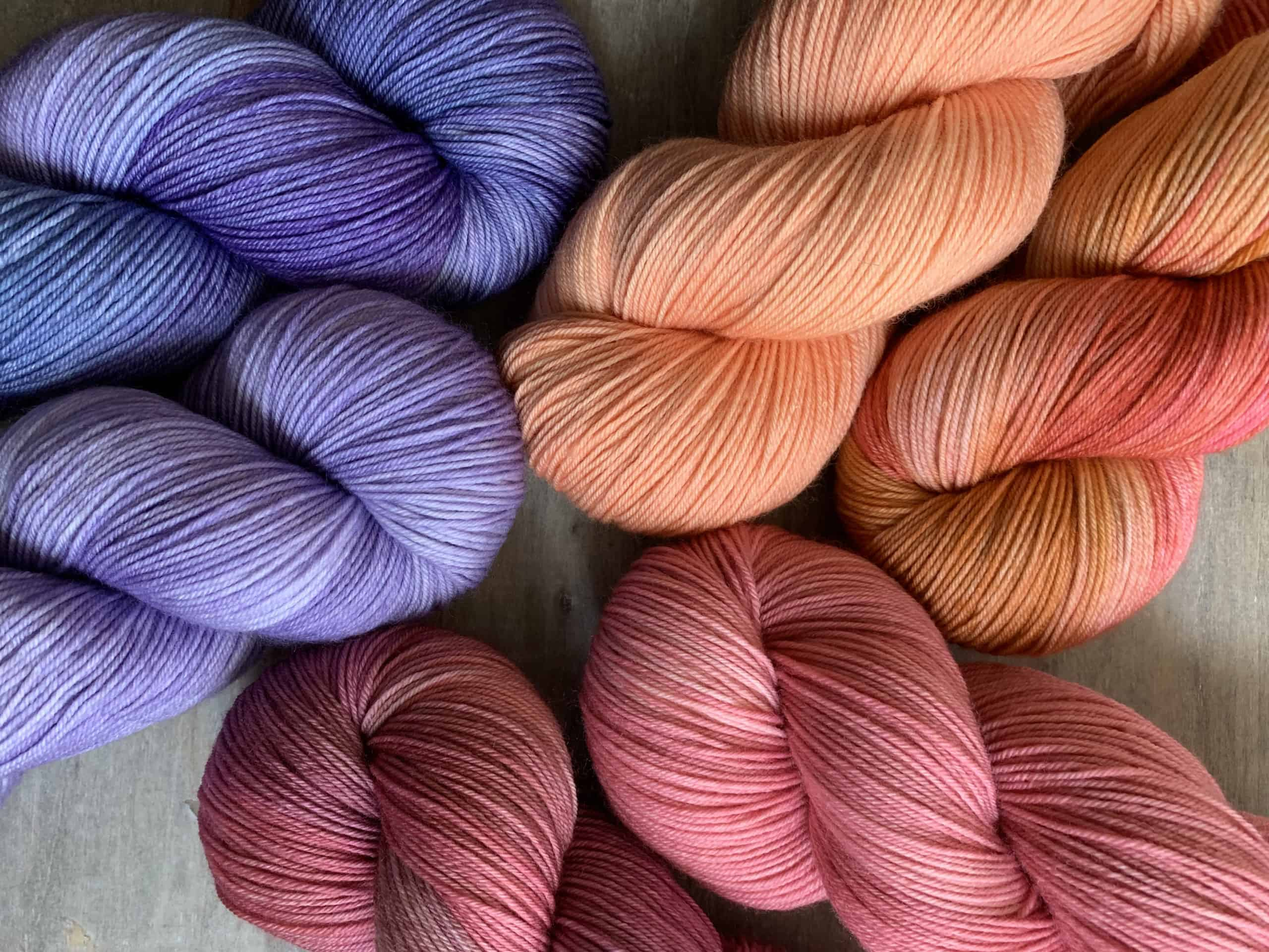 Purple, orange and pink yarn.