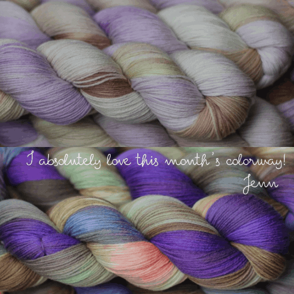 Skeins of purple and pale green yarn.