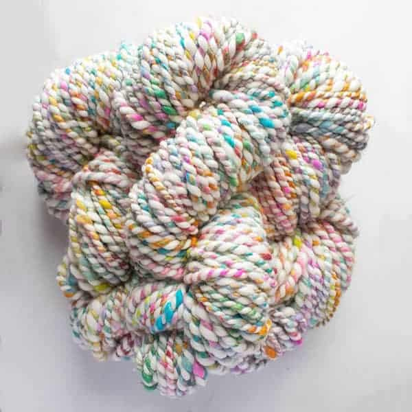 Blue, pink, orange and yellow yarn.