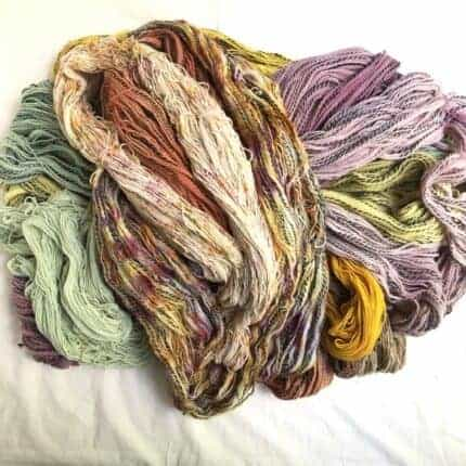 Pink, yellow, purple and brown speckled yarn.