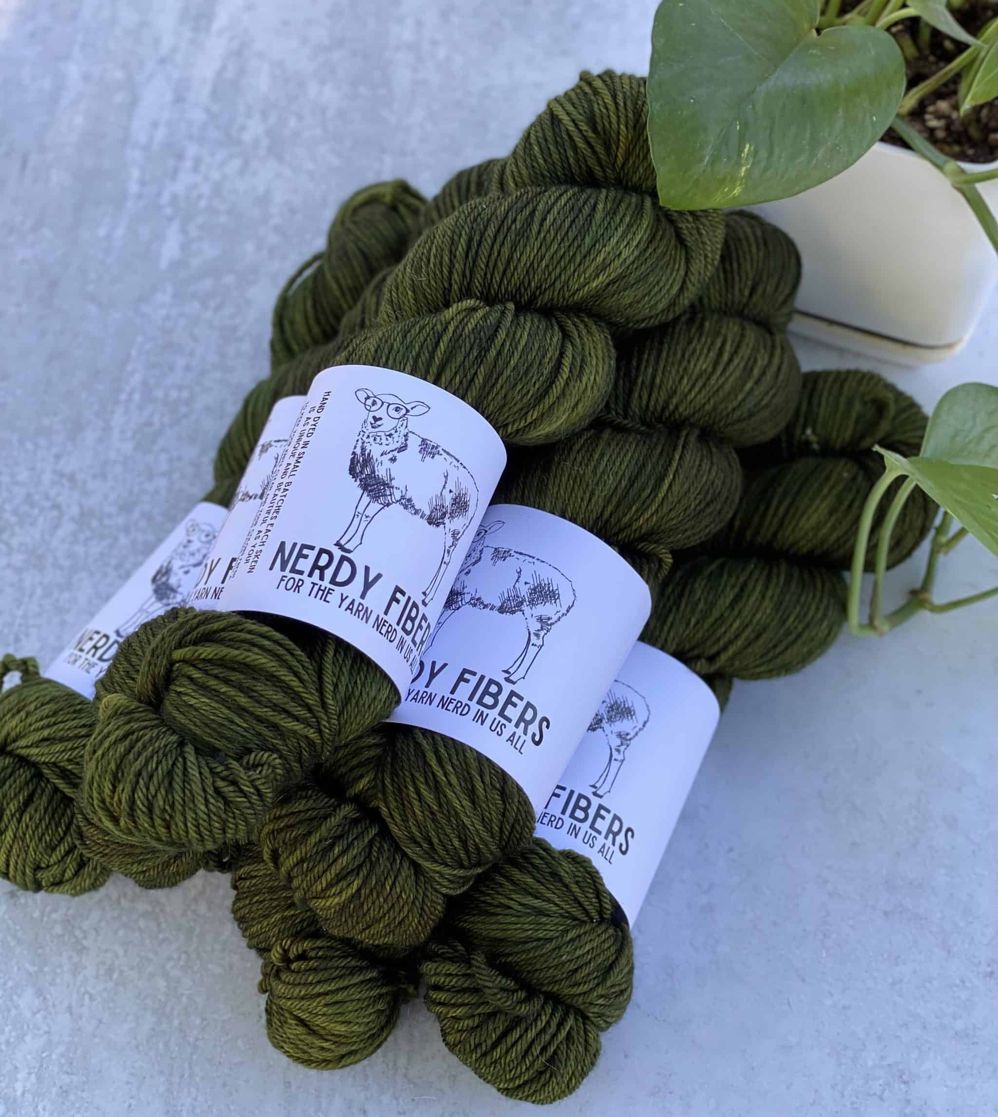 Skeins of mossy green yarn.