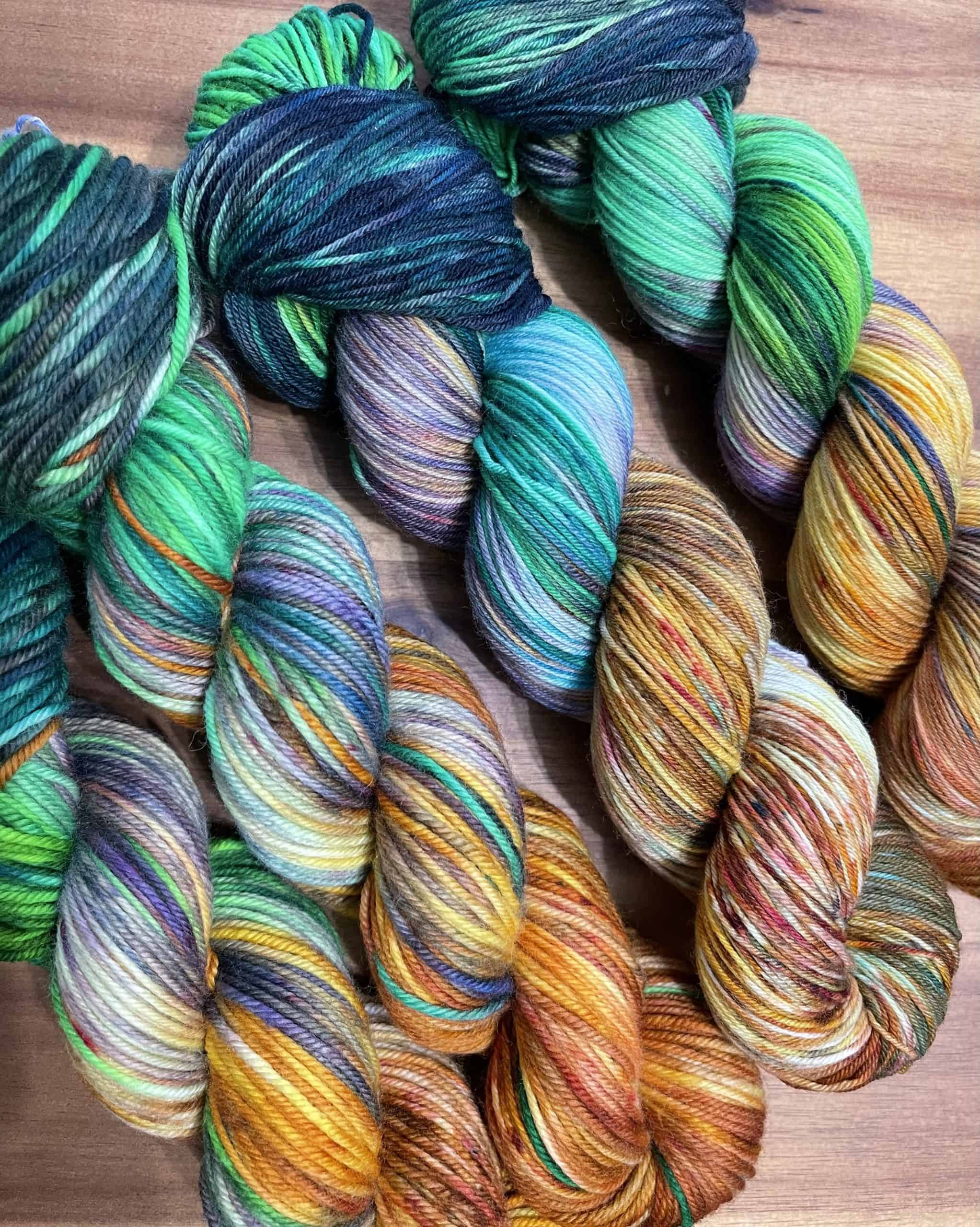 Green, gold, red and blue yarn.