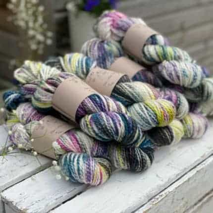 Purple and green hand-dyed chunky yarn.