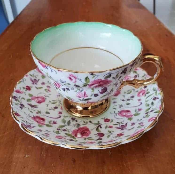 A teacup with pink flowers.