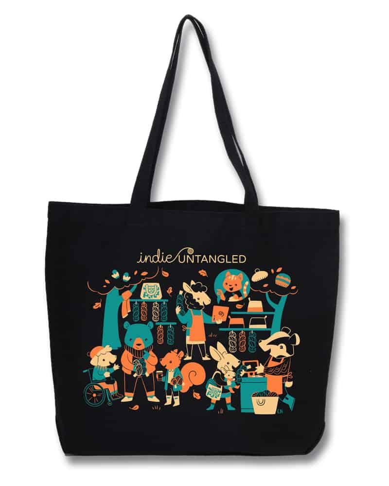 A black tote bag with a teal, orange and beige illustration.