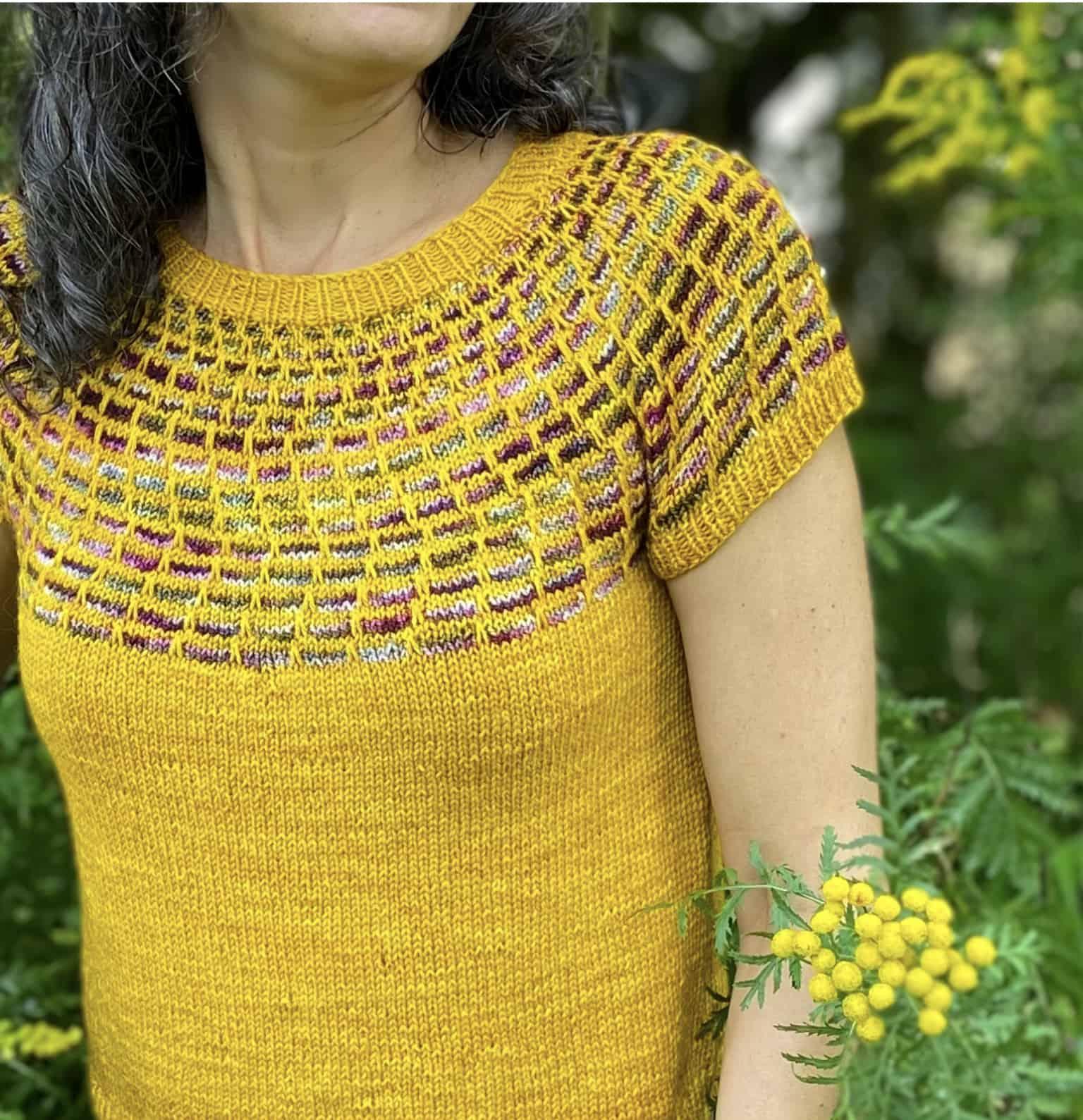 A yellow sweater with a variegated slipped-stitch yoke.