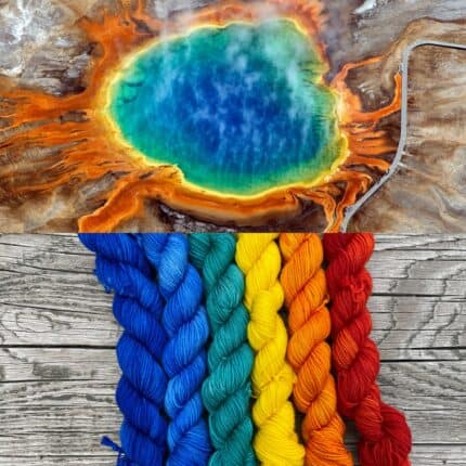 A rainbow hot spring collaged with rainbow yarn ranging from blue to red.