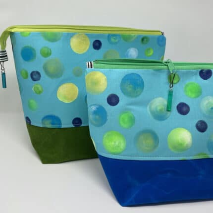 Blue zipper bags with green and gold polka dots.
