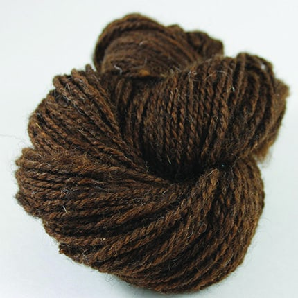 A twisted hank of black yarn with red undertones.
